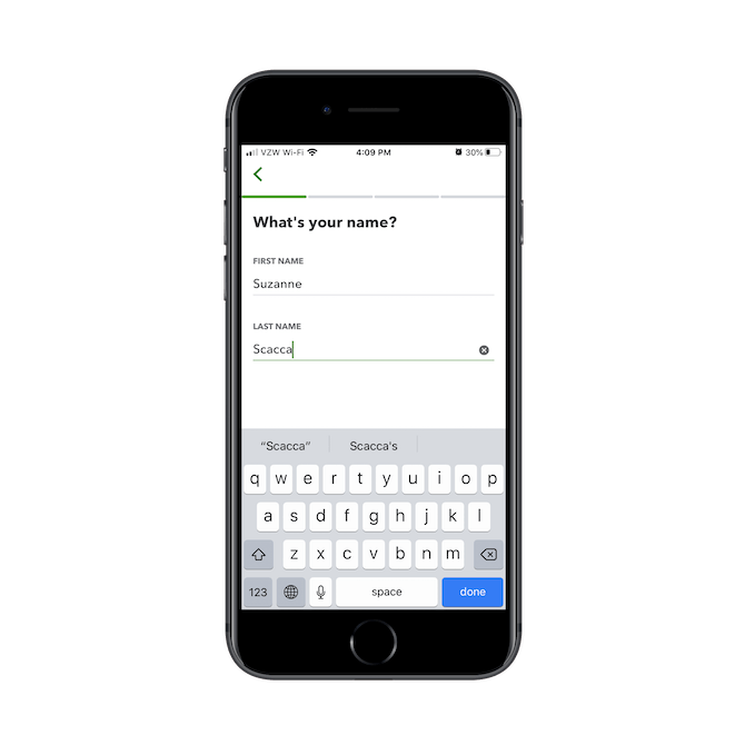 The QuickBooks mobile app asks for the user's name during onboarding.