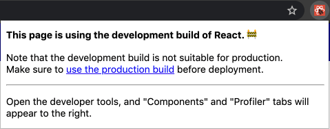 "Text says, ""This page is using the development build of React"" with a caution emoji. smaller text says, ""Note that the development build is not suitable for production. Make sure to use the production build before deployment."" The React logo in the upper right is white on a red background."