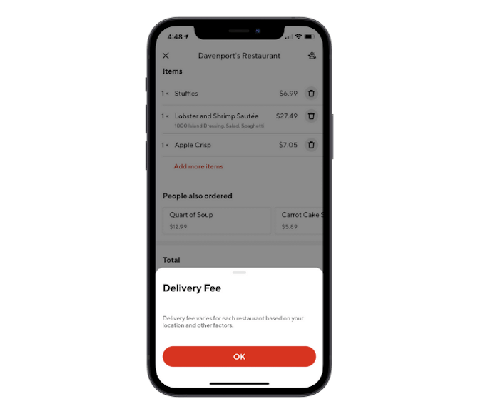 DoorDash app's explanation of its delivery fee appears as an overlay on the order page.