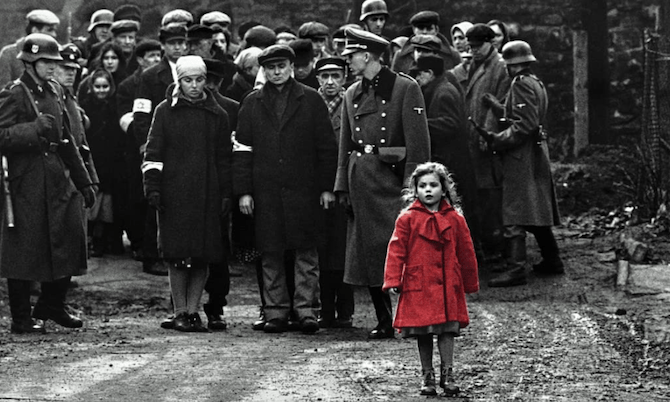 A movie still from Schindler's List showing a little girl in a red coat against the black-and-white backdrop of soldiers and prisoners.