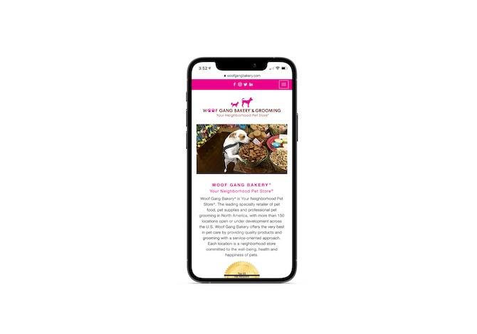 """The home page for the Woof Gang Bakery & Grooming: """"Your Neighborhood Pet Store"""". There's a sliding gallery of medium-sized images of the store and dogs shopping around at the top of the site, followed by a description of the store and services."""