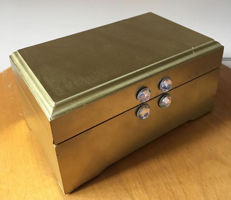 An upcycled wooden gift box makes a great treasure box